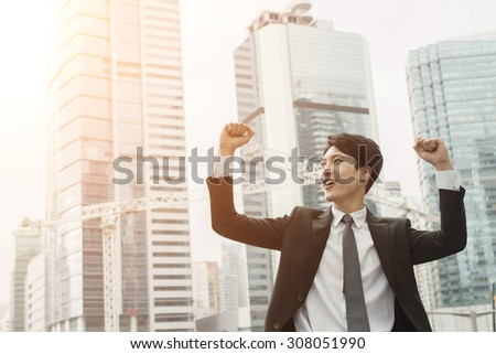 Cheerful Asian business man of success. - stock photo