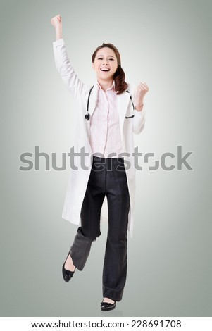 Cheerful Asian doctor woman dancing, full length portrait isolated on white background.