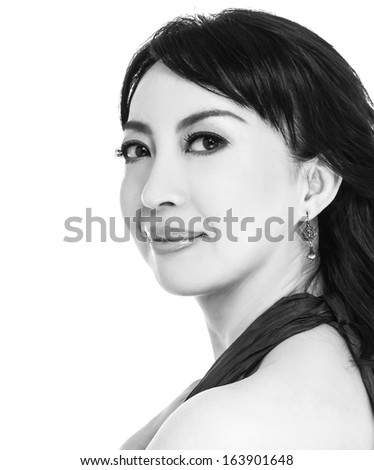 Cheerful asian lady posing in black and white