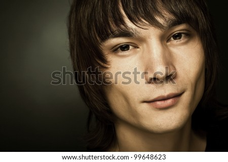 Cheerful Asian young man