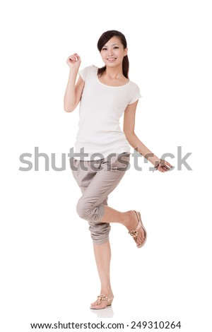 Cheerful Asian young woman posing, full length portrait on white background. - stock photo