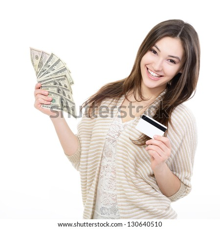 Cheerful attractive young lady holding cash with plastic card and happy smiling over white background - stock photo