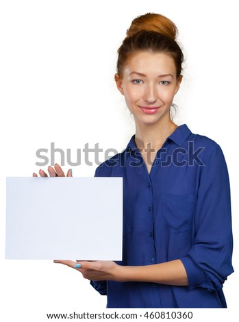 Cheerful attractive young woman showing blank sheet of paper with copy space