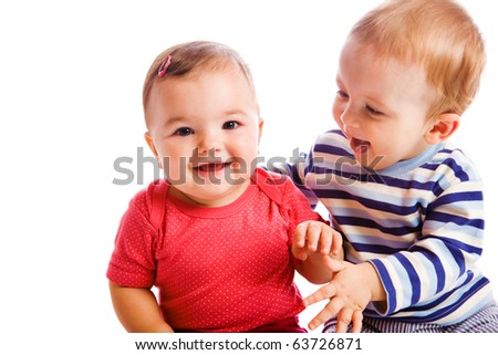 Cheerful babies playing - stock photo