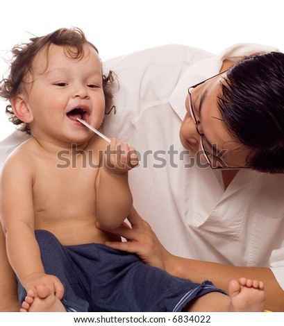 Cheerful baby at the doctor,isolated on a white background. - stock photo
