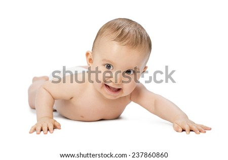 Cheerful baby boy laying down and crawling - stock photo