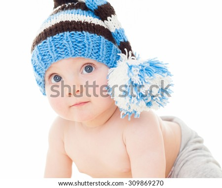 cheerful baby in the blue hat. Beautiful happy baby . One,isolated on white. - stock photo