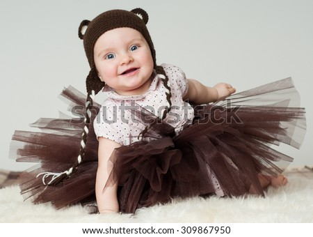 cheerful baby in the hat. Beautiful happy baby. Laughing baby.