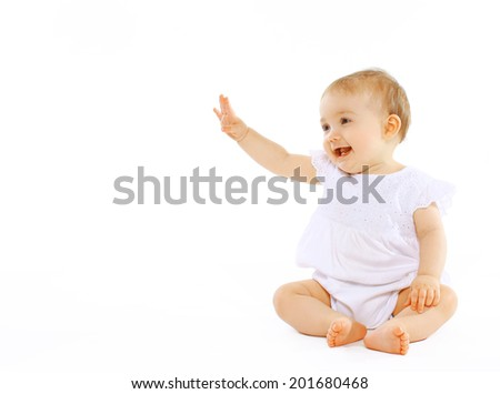 Cheerful baby on a white background - stock photo