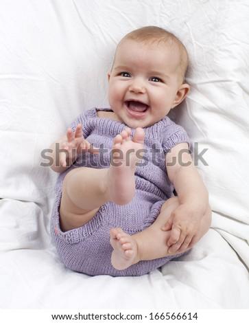 cheerful baby smiling - stock photo