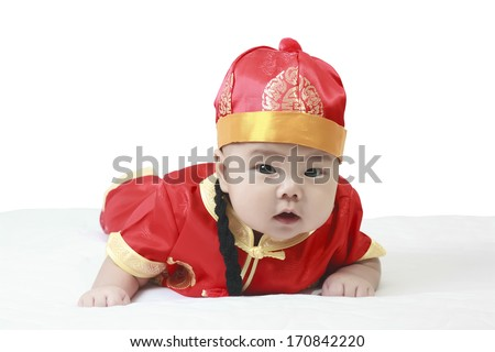 cheerful baby wearing Chinese New Year suit in studio - stock photo