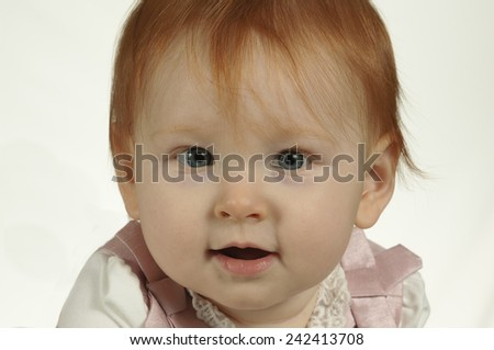 Cheerful baby with red hair