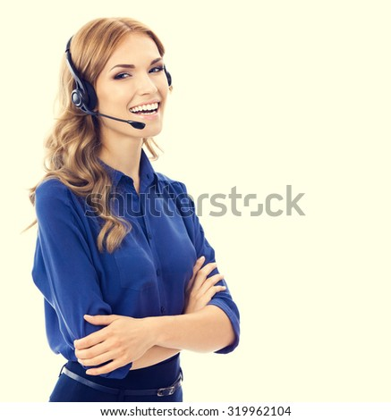 Cheerful beautiful young female support phone operator or phone worker in headset and blue clothing. Customer service assistance concept. - stock photo