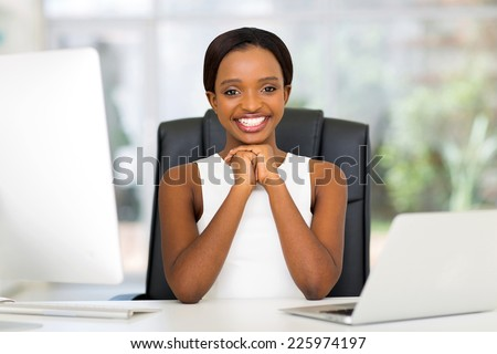 cheerful black businesswoman in modern office