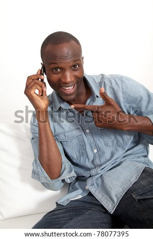 Cheerful black man talking on mobile phone - stock photo