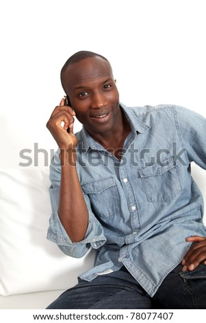 Cheerful black man talking on mobile phone