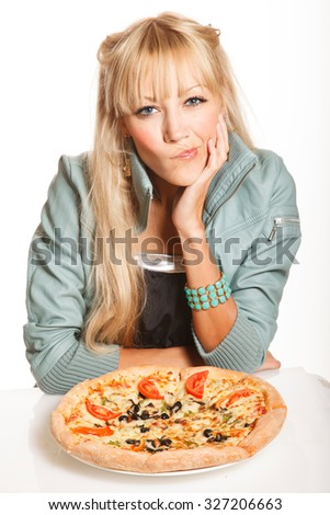 Cheerful blond fashion woman with pizza on white background,is guessing should she eat it