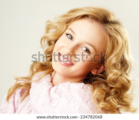 cheerful blond woman in a pink sweater. the winter season. - stock photo