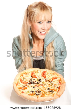 Cheerful blonde fashion woman holds pizza on white background