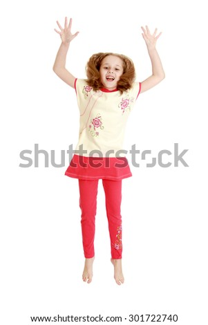 Cheerful blonde girl having fun jumping Studio. The girl waving his hands for joy-Isolated on white background - stock photo
