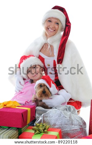 Cheerful boy and woman in christmas hat. Isolated on white background - stock photo