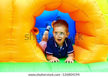 cheerful boy having fun on playground - stock photo