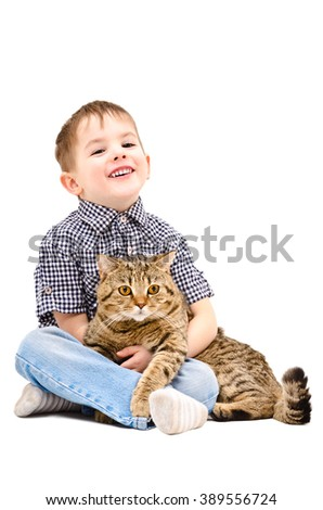 Cheerful boy hugging a cat Scottish Straight isolated on white background - stock photo