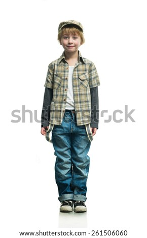 Cheerful boy in a jeans on the white background - stock photo