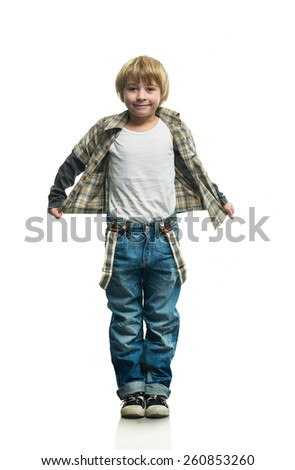 Cheerful boy in jeans on the white background - stock photo