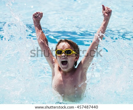 Cheerful boy in swimming pool - stock photo