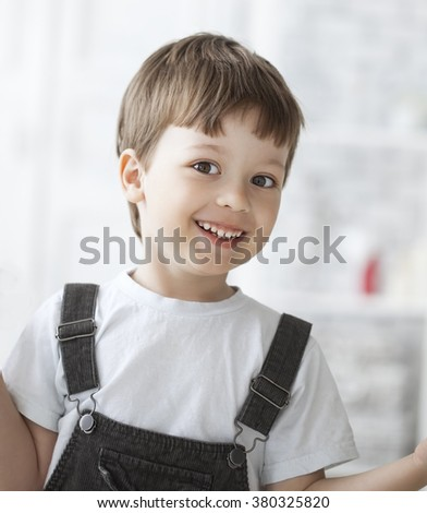 cheerful boy indoors - stock photo