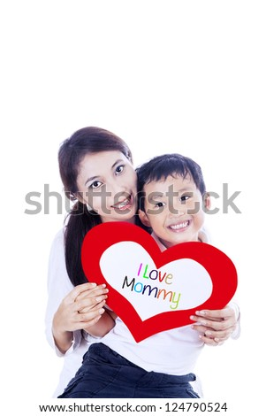 Cheerful boy is giving a love card to his mother on white background - stock photo