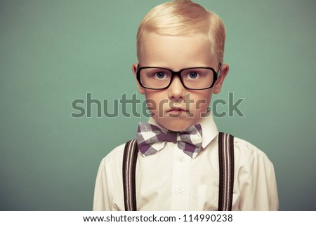 Cheerful  boy on a green background. - stock photo