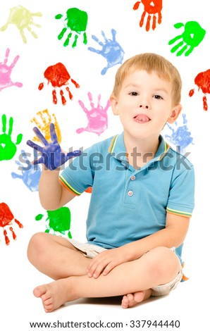 Cheerful boy sitting with hand painted, on the background of handprints - stock photo
