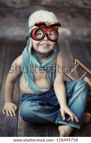 Cheerful boy smiling - stock photo