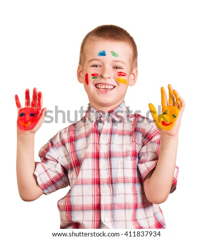 Cheerful boy with a face and palms painted with paint isolated on white background. - stock photo