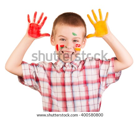 Cheerful boy with paint on his face and palms isolated on white background. - stock photo