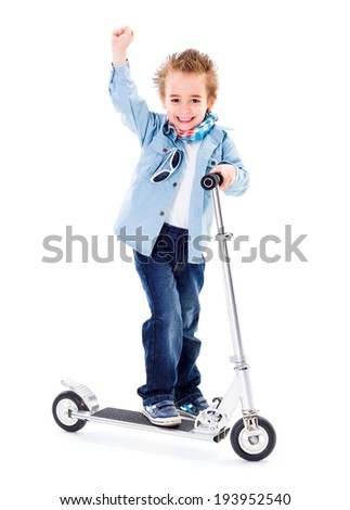 Cheerful boy with raised hand on scooter white background - stock photo