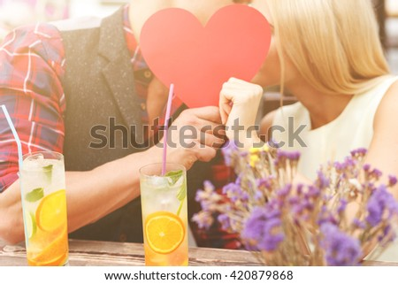 Cheerful boyfriend and girlfriend dating in cafeteria - stock photo