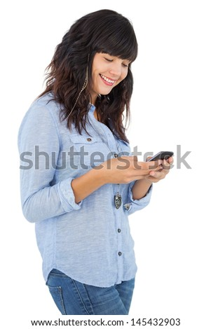 Cheerful brunette with her mobile phone texting a message on white background