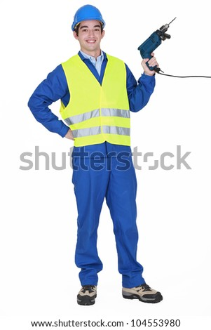 Cheerful builder holding drill - stock photo