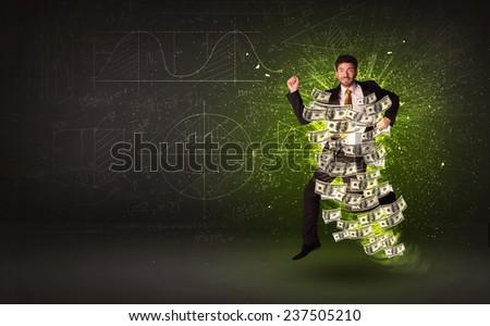 Cheerful businesman jumping with dollar banknotes around him on background - stock photo