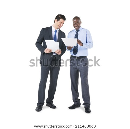 Cheerful Business Colleagues Discussing about the Documents