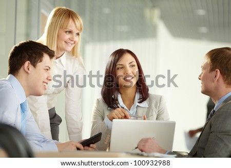 Cheerful business group holding a meeting looking for new business solutions - stock photo