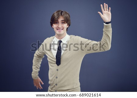 Cheerful business man with arms raised in success isolated on white background