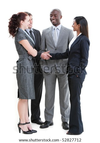 Cheerful business partners shaking hands standing against a white background - stock photo
