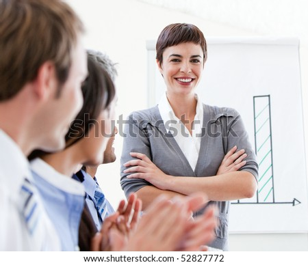 Cheerful business people applauding a good presentation in the office - stock photo