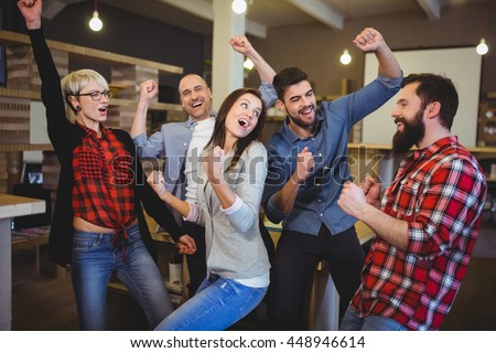 Cheerful business people enjoying in creative office - stock photo