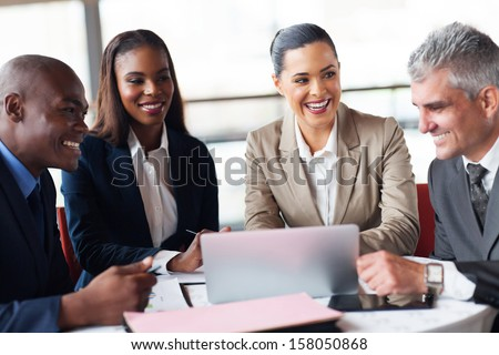 cheerful business people in a meeting at office - stock photo