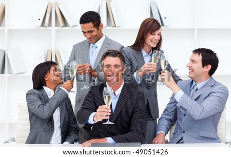Cheerful business people toasting with Champagne to celebrate a success - stock photo